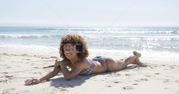 Сток-фото: улыбаясь · женщины · солнечные · ванны · пляж · желудка · морем