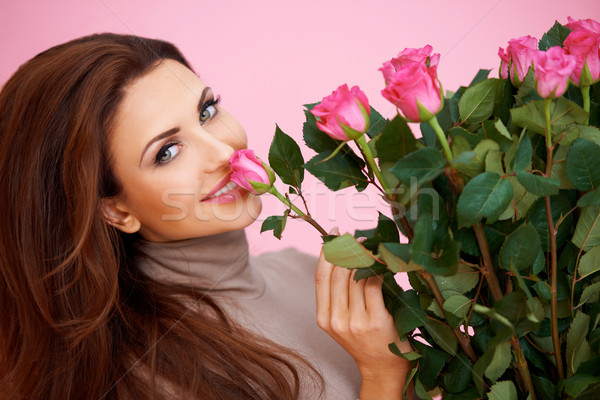 Beautiful woman smelling a rose Stock photo © dash