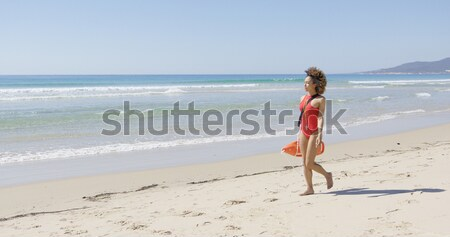 Female with flippers standing on beach Stock photo © dash