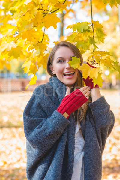 Laughing vivacious woman in an autumn park Stock photo © dash
