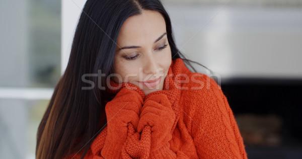 Woman cuddling down in her warm winter fashion Stock photo © dash