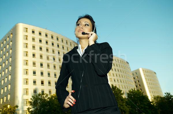 Iş açık havada iş kadını kulaklık şehir çalışmak Stok fotoğraf © dash