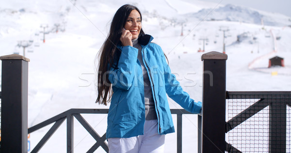 Attractive young woman at a mountain ski resort Stock photo © dash