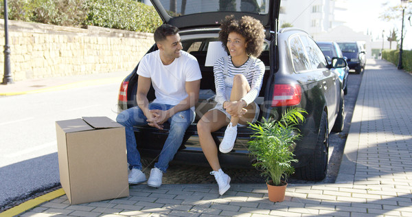 Young couple relaxing while moving house Stock photo © dash