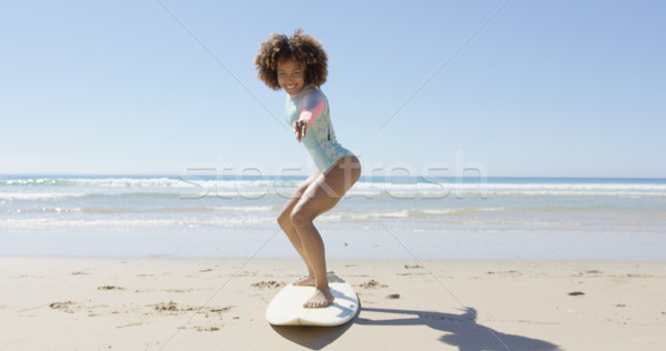 Cheerful woman on a surfboard Stock photo © dash