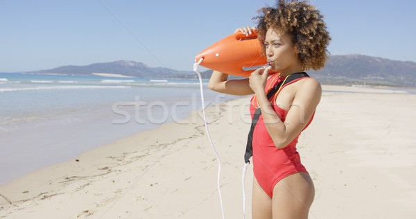 Lifeguard blowing a whistle holding rescue float Stock photo © dash