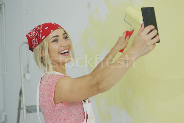 Painting wall woman taking selfie Stock photo © dash