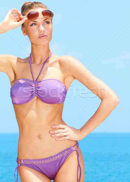 Pretty female with sunglasses at the pool Stock photo © dash