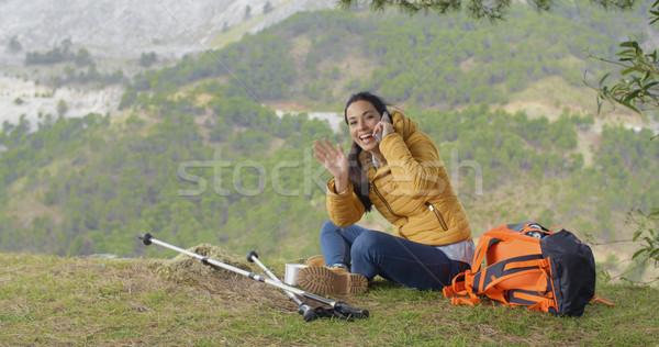Happy backpacker on phone and waving hand Stock photo © dash
