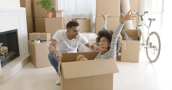 Happy mixed race couple having fun break with unpacking Stock photo © dash