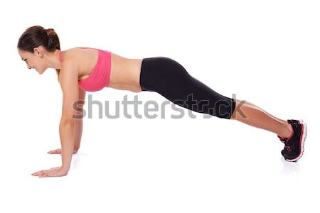 Fit woman doing press ups Stock photo © dash