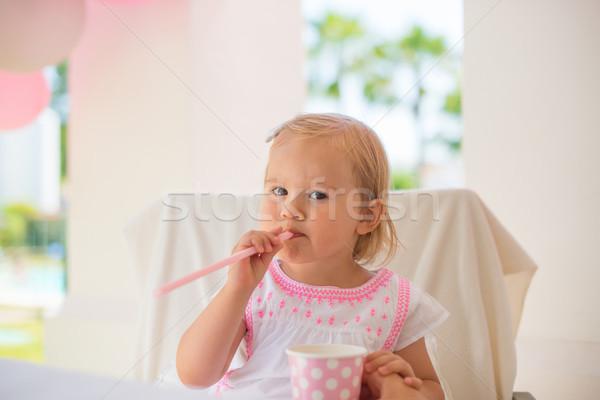 Baby Girl Sitting Next To Table Stock photo © dash
