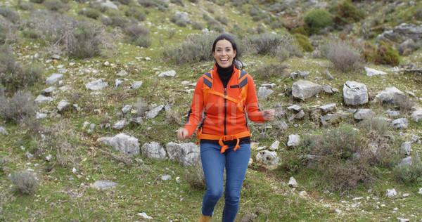 Vivacious woman enjoying a mountain hike Stock photo © dash