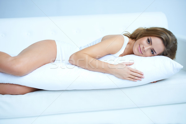 Young pregnant woman laying on sofa Stock photo © dash