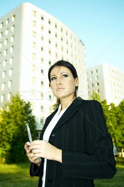 Iş açık havada iş kadını cep telefonu çim şehir Stok fotoğraf © dash