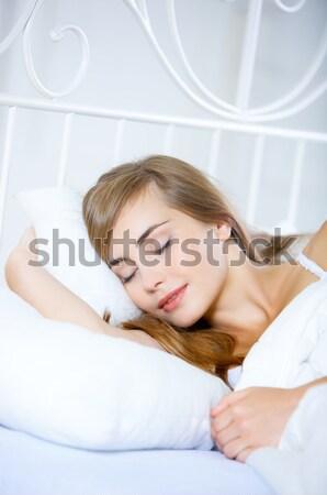 Fáradt fiatal nő alszik nappal ágy nap Stock fotó © dash