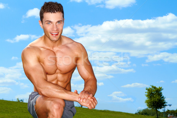 Sporty muscular man at field Stock photo © dash