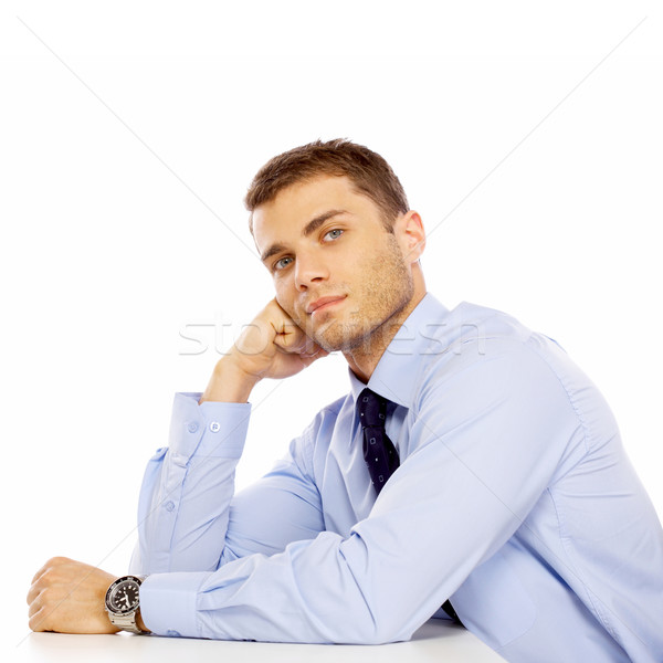 Sitting Young Salesman with Hand on Face Stock photo © dash