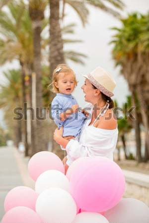 Trendy young mother holding her young daughter Stock photo © dash