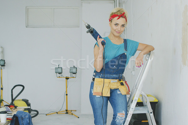 Woman with drill standing on stepladder  Stock photo © dash