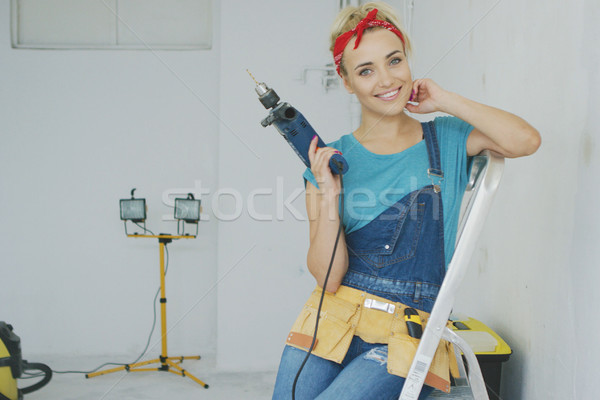 Happy woman with drill sitting on stepladder  Stock photo © dash