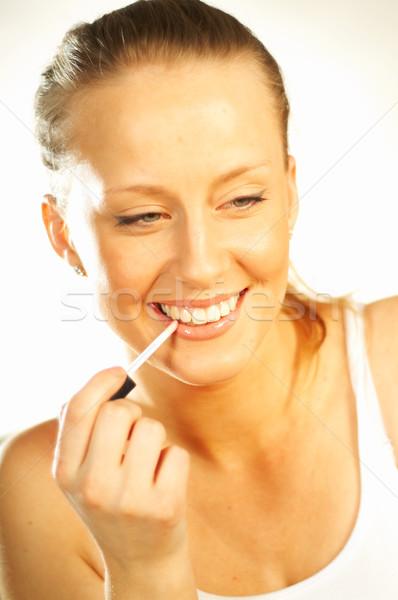 Girl doing makeup Stock photo © dash