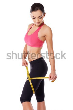 Shapely woman measuring her thigh Stock photo © dash