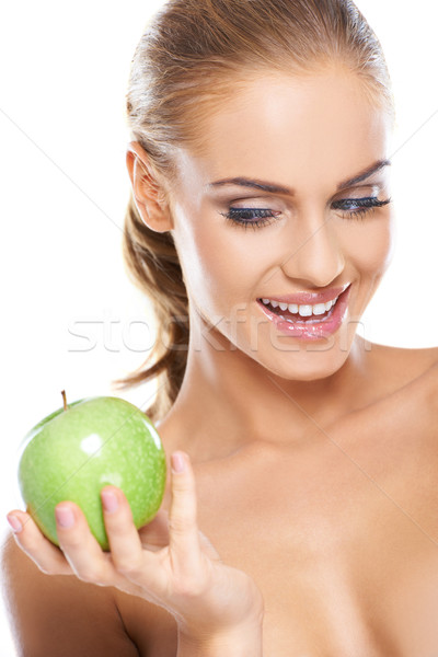 Happy woman with a crisp green apple Stock photo © dash