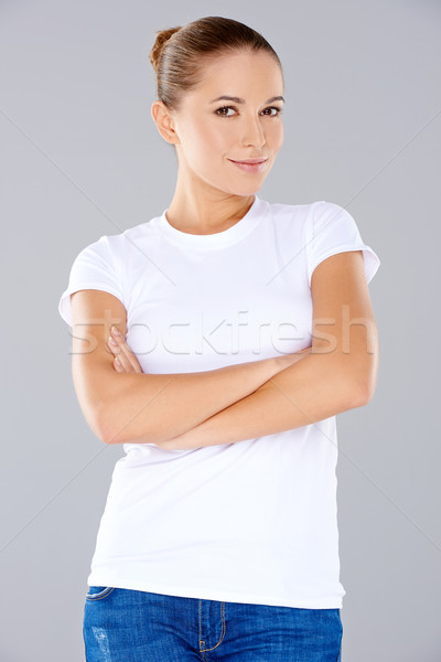 Smiling thoughtful young woman Stock photo © dash