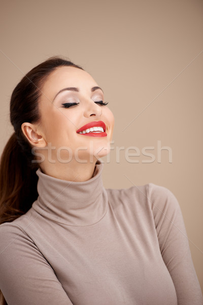 Stock photo: Pretty Woman in Closed Neck Fashion Daydreaming