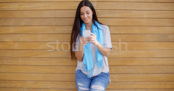 Mujer pared sonriendo Foto stock © dash