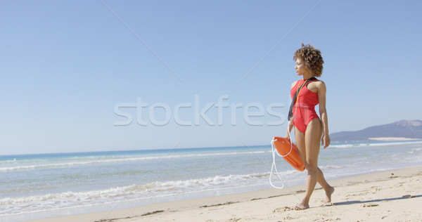 Lifeguard female with rescue float Stock photo © dash