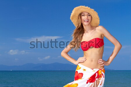 Coy blonde beauty in a red bikini Stock photo © dash