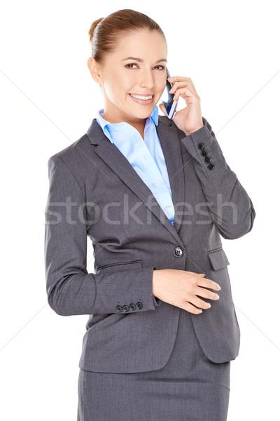 Encantado empresária móvel jovem sorrir Foto stock © dash