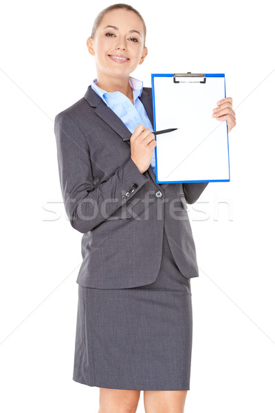 дружественный деловая женщина указывая буфер обмена лист бумаги Сток-фото © dash