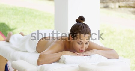 Tranquil spa customer relaxes on table Stock photo © dash