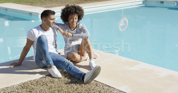 Young woman relaxing with her boyfriend poolside Stock photo © dash
