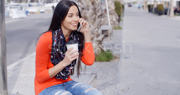 Trendy chic young woman listening to a mobile call Stock photo © dash