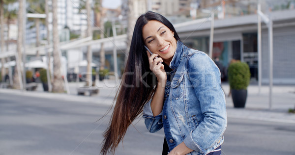 Happy casual young woman swinging her hair Stock photo © dash