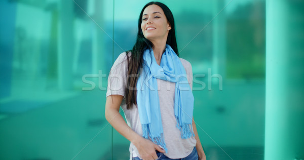 Happy woman looking sideways in front of glass Stock photo © dash