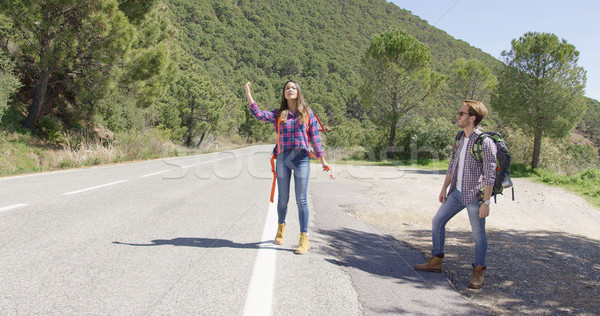 Young travellers hitch hiking on road Stock photo © dash
