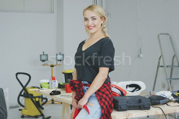 Beautiful stylish woman standing at workbench Stock photo © dash
