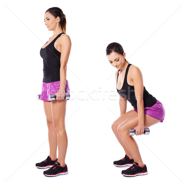Stock photo: Young woman working out with barbells