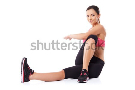Woman doing body twist exercises Stock photo © dash