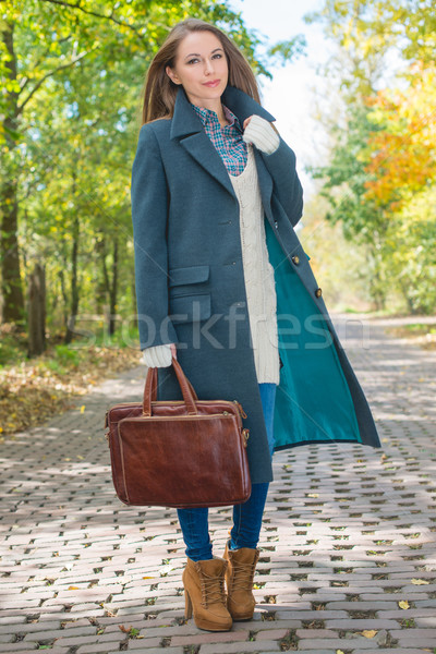 Young Woman in Autumn Season Attire at Pathway Stock photo © dash