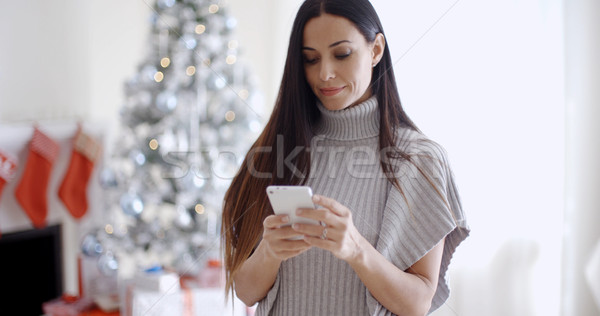 Attractive young woman reading a text message Stock photo © dash