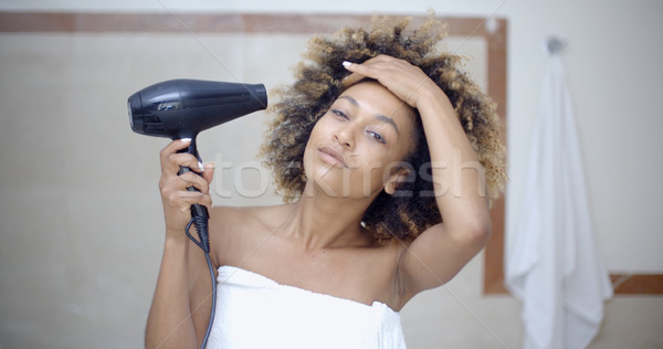 Woman Drying Her Hair With Hairdryer Stock photo © dash