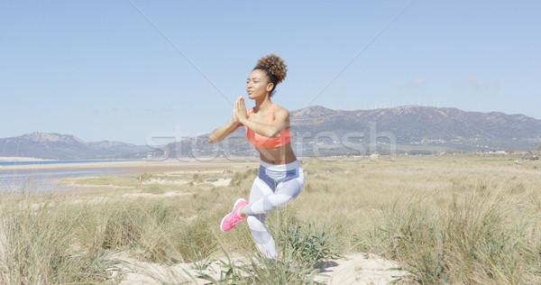 Woman doing yoga on the beach Stock photo © dash