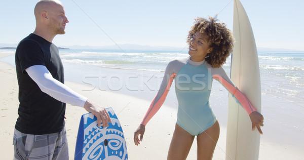 Gente che parla spiaggia sorridere uomo donna Foto d'archivio © dash