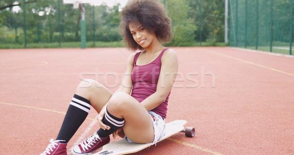 Cheerful model posing on longboard Stock photo © dash
